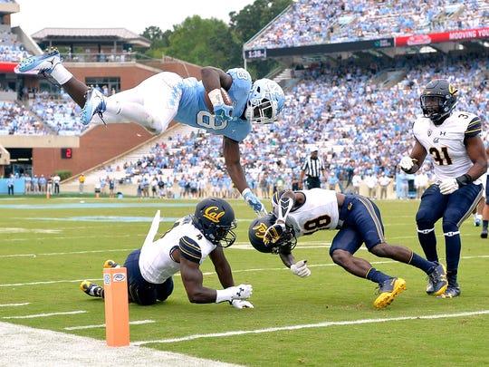 North Carolina running back Michael Carter hurdles