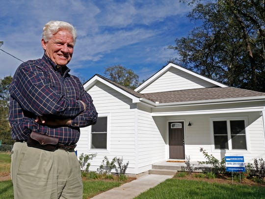 Eddie Latimer, CEO of Affordable Housing Resources, poses for a photo in front of one of the houses in Nashville people are entering to win the chance to buy without having to compete with other buyers.