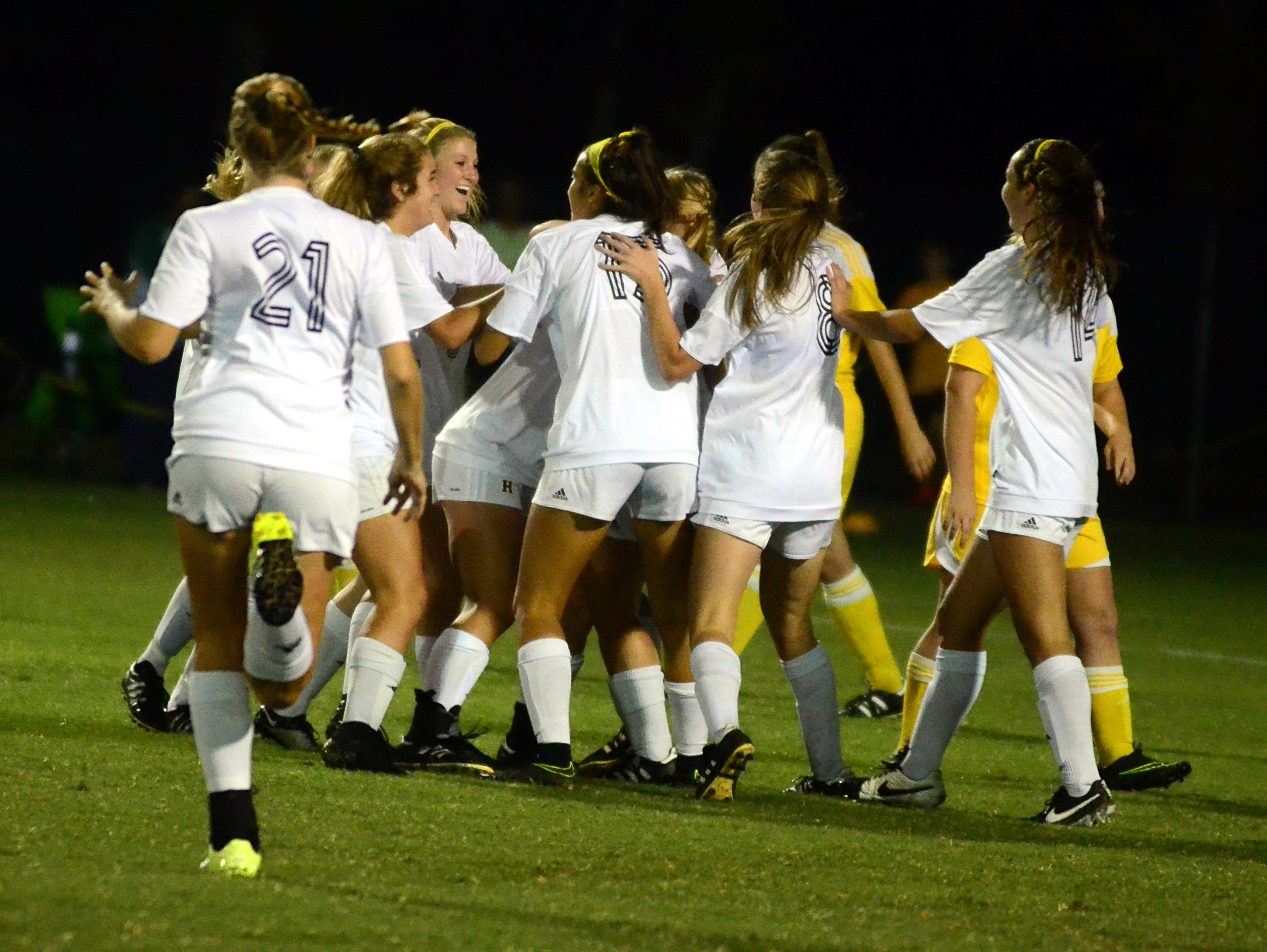 Teammates congratulate Hendersonville senior Jada Campbell after the first of her two goals during Thursday's 6-3 victory over Gallatin.