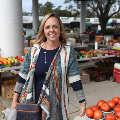 Dietitian Anna Jones stands at the Market Square Farmer's