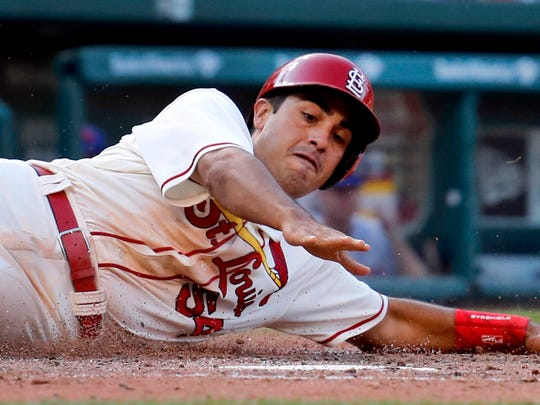 St. Louis Cardinals' Alex Mejia scores during the eighth inning of a baseball game against the New York Mets, Saturday, July 8, 2017, in St. Louis.