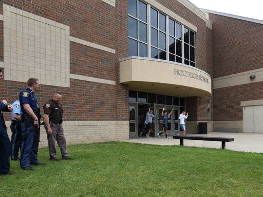First responders worked with Holt High School staff