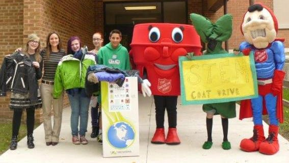STEM Institute had mascot support to drive their coat collection competition. From Left: Ivy Bolthouse, teacher Kelly Bobo, Kaylee Radue, Epiphany Rhoads, Ike Holzmann, Willy Millard as Salvation Army Captain Kettle, John Drehmel as STEM mascot and Salvation Army Captain Food.