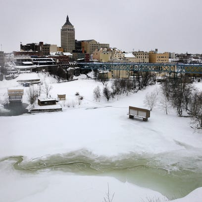 The Genesee River is almost frozen over at the base