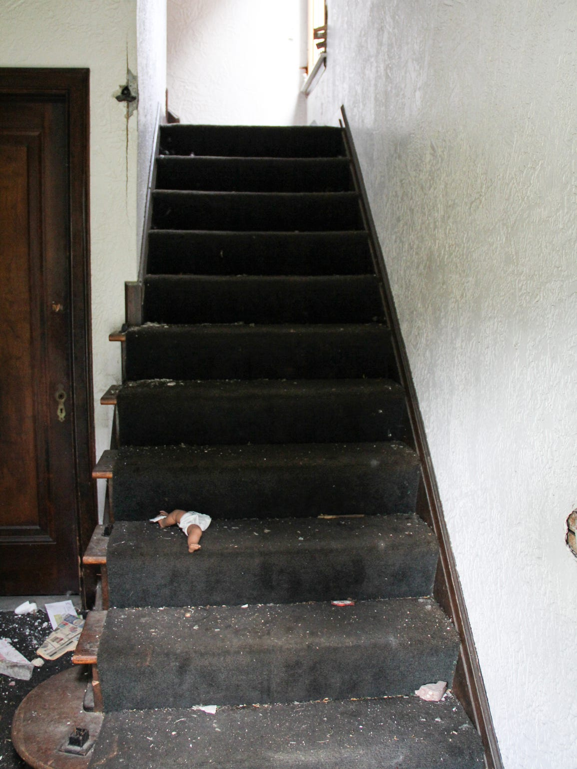 Carpeted stairs now lead to the second-floor apartment