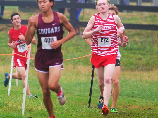 Beechwood's Keaton Downey, right, finished 12th in 1A during the KHSAA state championship cross country meet Nov. 4, 2017, at Kentucky Horse Park.