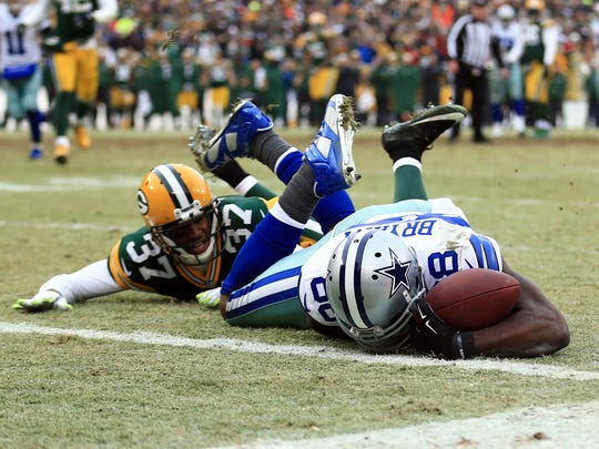 Dallas Cowboys wide receiver Dez Bryant (88) is unable to catch a pass against Green Bay Packers cornerback Sam Shields (37) in the fourth quarter in the 2014 NFC Divisional playoff football game at Lambeau Field on Jan 11, 2015.