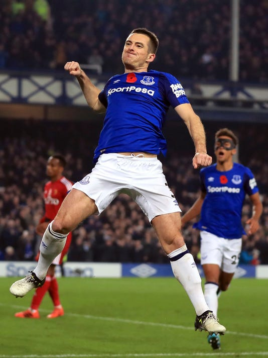 Everton's Leighton Baines celebrates scoring his side's third goal against Watford during the English Premier League soccer match at Goodison Park, Liverpool, England, Sunday Nov. 5, 2017. (Peter Byrne/PA via AP)