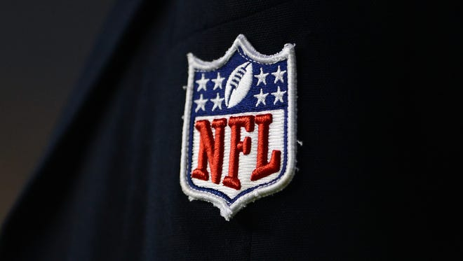Detailed view of the NFL shield logo at Ford Field.
