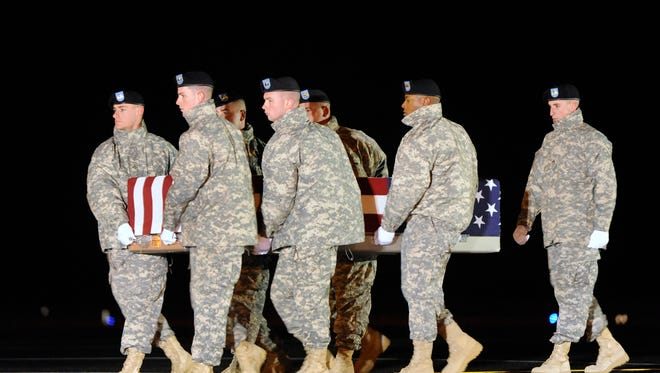 An Army carry team moves a transfer case containing the remains of Sgt. Maj. Wardell B. Turner Wednesday, Nov. 26, 2014 at Dover Air Force Base, Del. According to the Department of Defense, Turner, 48, of Nanticoke, Md., died Nov. 24, 2014 in Kabul, Afghanistan of wounds sustained when his vehicle was attacked with an improvised explosive device. (AP Photo/Steve Ruark)