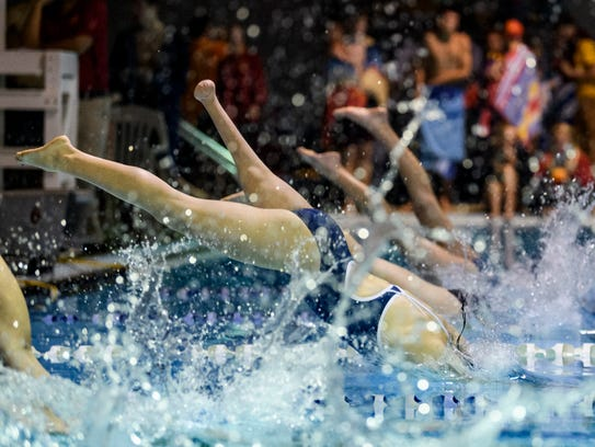 Reitz freshman Mikaela Jenkins dives into the pool