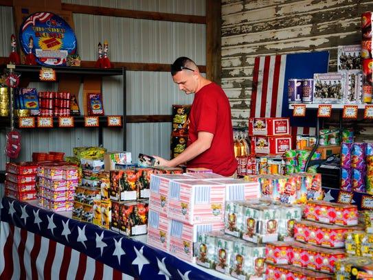 Brant Archer of shops for fireworks at Shooters Fireworks