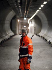 An armed guard stands in the entrance tunnel to the