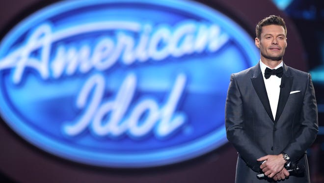 """Ryan Seacrest performs at the """"American Idol"""" farewell season finale at the Dolby Theatre on Thursday, April 7, 2016, in Los Angeles."""