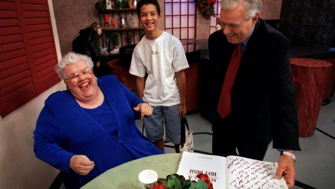 Hazel Smith laughs with Harry Chapman after he read what she inscribed in the front of her new cookbook. Between them is Hazel's grandson Jeremy Smith, 14 yrs., who accompanied her down to the station for the program.