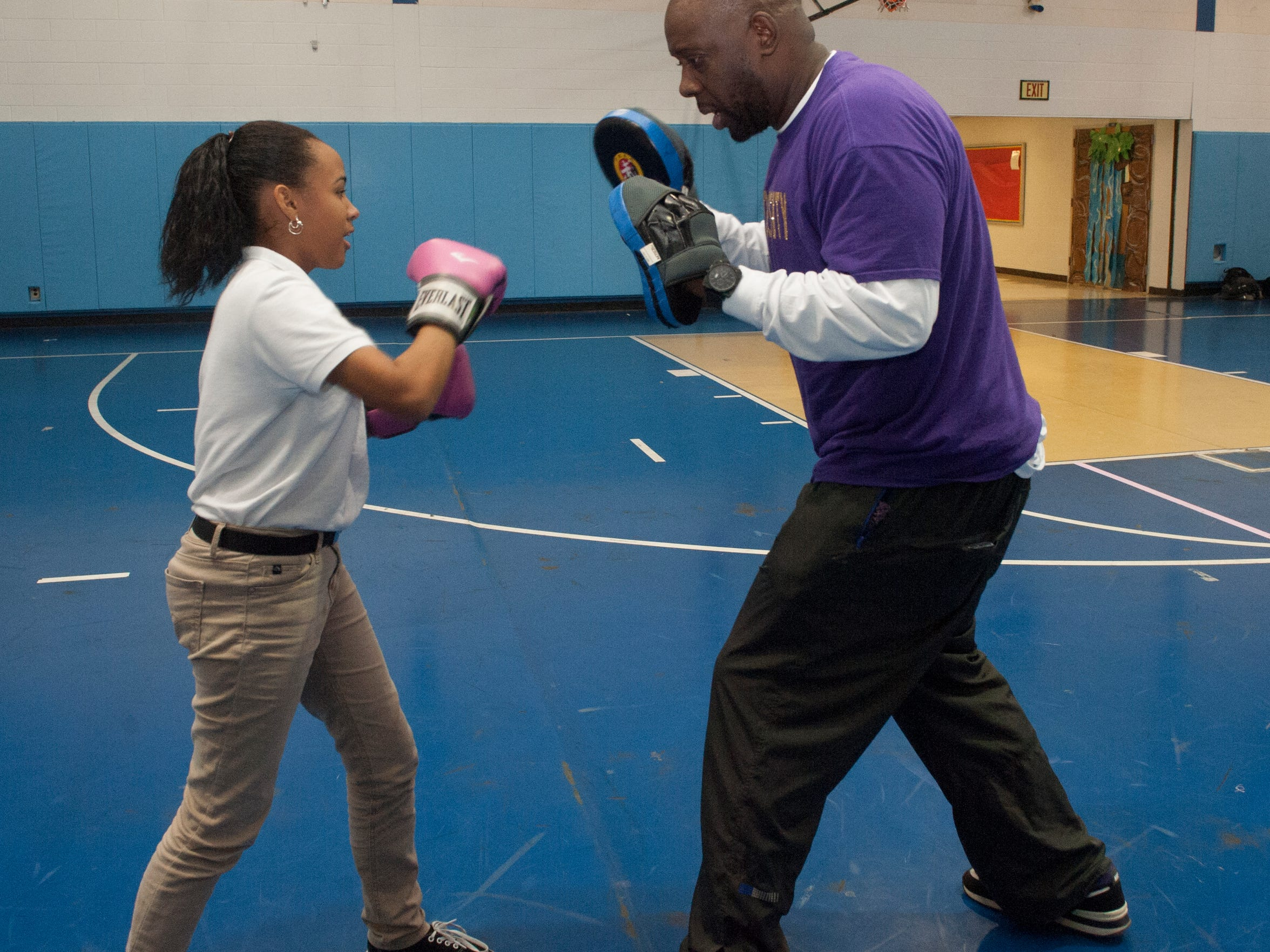 Boxing Instructor Wayne Shareef works with Camden East Middle School student Moisha Chevere during a Camden Program to help combat obesity in kids.