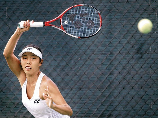 MARK LAMBIE—EL PASO TIMES  Mayo Hibi of Japan returns a shot to American Sanaz Marand during their match Friday in the Hunt 2015 25,000 Women's Tennis Classic at Tennis West. Hibi won the match 6-1, 2-6, 7-5.