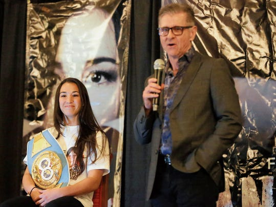 El Pasoan Jennifer Han is all smiles as Lester Bedford, the fight's on-site coordinator, talks about Han possibly becoming El Paso's first world boxing champion on Wednesday. Han faces Helen Joseph on Sept. 19 for the IBF world featherweight championship.