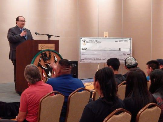 Mescalero Apache President Danny Breuninger addresses graduating seniors.