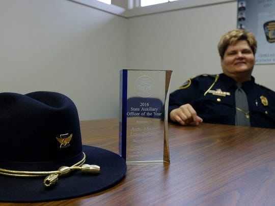 The 2016 State Auxiliary Officer of the year award was presented to Highway Patrol Auxiliary Maj. Lois J. Lust who has been an auxiliary officer for 22 years.