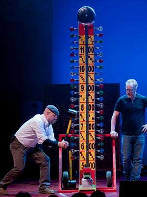"""Adam Savage (right) and Jamie Hyneman of """"MythBusters"""" demonstrate a High Striker carnival game in their touring show."""