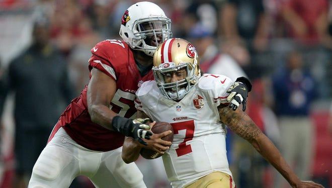 Arizona Cardinals outside linebacker Alex Okafor (57) sacks San Francisco 49ers quarterback Colin Kaepernick. Okafor has signed a one-year contract with the New Orleans Saints.