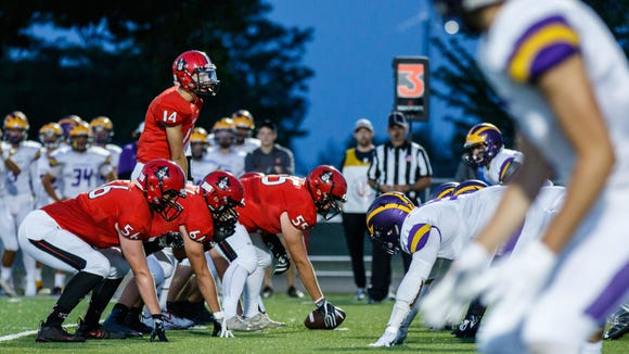 Pewaukee quarterback Josh Swanson (14) looks across