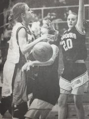 Bravette Alison Morris was fouled hard in a game against Madisonville by Lady Maroon Jenny Johnson in January 1996.