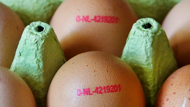 A major supermarket chain is removing all eggs from sale in its German stores amid a scare over possible pesticide contamination. (AP Photo/Michael Probst)