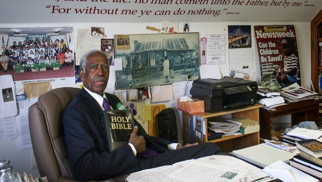 "Pastor Jimmy Terry sits in his office at the Tabernacle Baptist Church. Terry started the yard sign campaign ""Easter is all about Jesus"" and ""Christmas is all about Jesus."""