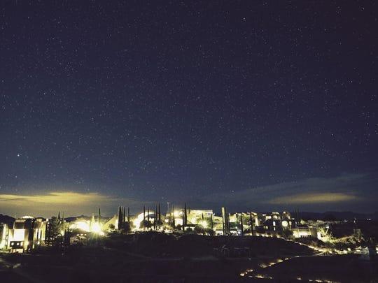 A view of FORM Arcosanti at night.