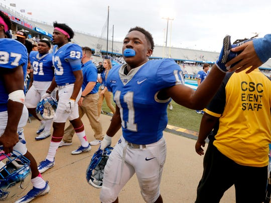 MTSU's Brad Anderson (11) interacts with the crowd as he leaves the field after beating FIU 37-17, on Saturday, Oct. 7, 2017, at MTSU