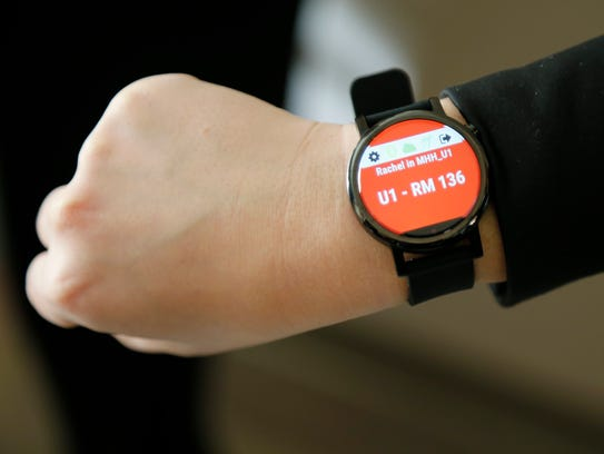 "A nurse shows her connected smartwatch which monitors the Palarum Pup ""smart socks"" system, giving notifications of patients leaving their bed which can result in falls, at Madison Health in London, Ohio, on Tuesday, Oct. 31, 2017."