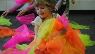 Colorful scarves are one prop in music-based activities in the Early Childhood Music Education program at Michigan State University's Community Music School. Research has found that music helps young children develop language skills.