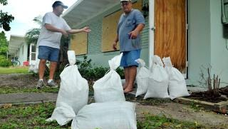 Craig Sutton and Steve Taylor of Cape Canaveral got ready to sandbag their apartments last year as they prepared for the impact of hurricane Matthew .
