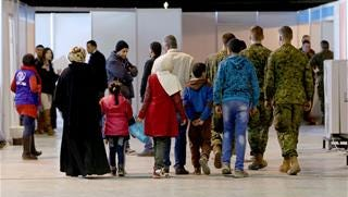 Syrian refugees wait at Marka Airport in Amman, Jordan, on Tuesday, Dec. 8, 2015 to complete their migration procedures to Canada.