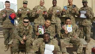 Overseas troops show off the treats received from Operation Troop Treats.