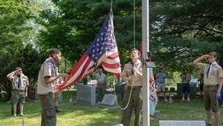 Boy Scout Troop 1699 performed the flag-raising ceremony at the Memorial Day event at historic Franklin Cemetery. The scouts also placed a flag on every veteran's grave site.