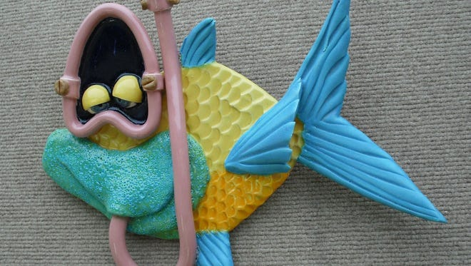 "Canaveral's Jeff and Kathy King use clay and slab techniques to create fantastical, anthropomorphic sea creatures such as ""Blowing Bubbles."" The couple are exhibiting their works at the Indialantic Craft Festival July 7 and 8."