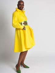 Betty Price of Smyrna models a bright-yellow Keza by Ashro shirt dress with a wide green-and-gold belt, green-tea kitten heels and yellow sterling hoop earrings.