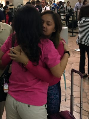 Leaving close family and friends will always be the hardest goodbyes. Mica Almira hugs family as she leaves Guam for college in San Diego.