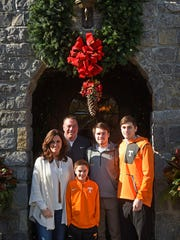Butch Jones at home with his wife Barb and three sons: