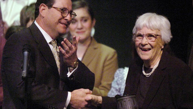 """Al Head, executive director of the Alabama State Council on the Arts, presents  author Harper Lee with a token of appreciation Jan. 10, 2007, at a production of ?To Kill a Mockingbird? at the Davis Theatre in Montgomery. Advertiser fileAl Head, executive director of the Alabama State Council on the Arts, left, presents Alabama author Harper Lee with a token of appreciation Wednesday night, Jan. 10, 2007 at a production of Lee's """"To Kill a Mockingbird"""" at the Davis Theater in Montgomery, Ala. Montgomery Advertiser, Karen S. Doerr"""