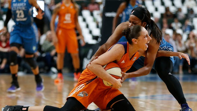 Phoenix Mercury's guard Diana Taurasi calls out to the ref while fighting for possession of the ball against Minnesota Lynx's guard Jia Perkins during the first half of Game 2 of the WNBA basketball semifinals, Friday, Sept. 30, 2016, in St. Paul.