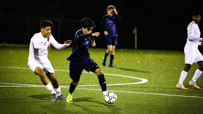 Olathe West's Jony Munoz (middle) became the first Kansan in any sport to earn a national Gatorade player of the year honor when he was named the Boys Soccer National Player of the Year on Wednesday. Munoz led Olathe West to the Class 6A title last fall and Thursday night was named the Best of Kansas Preps Boys Soccer Player of the Year.