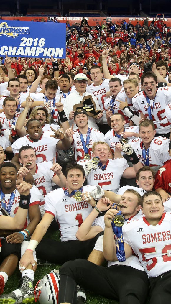 Somers players celebrate their 25-17 victory over Greece Athena to win the New York State Class A championship game at the Carrier Dome in Syracuse, N.Y. Nov. 25, 2016.