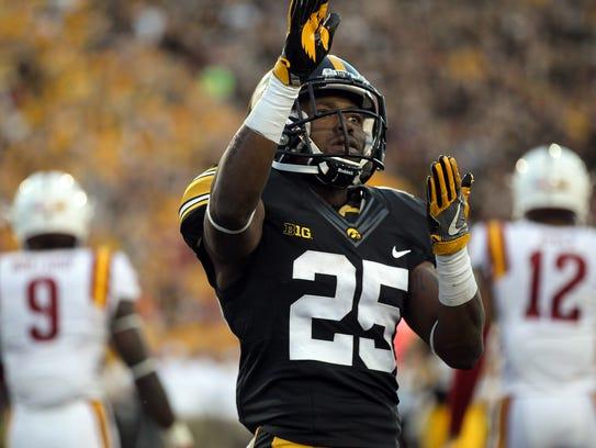 Iowa running back Akrum Wadley celebrates his 26-yard