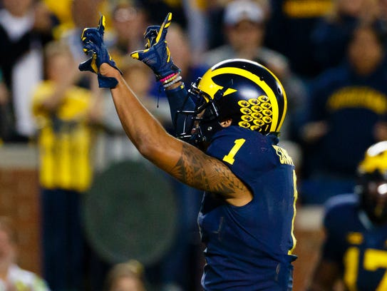 Michigan wide receiver Kekoa Crawford celebrates his