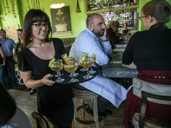 Tricia Troyan of Detroit serves the first drink pairing