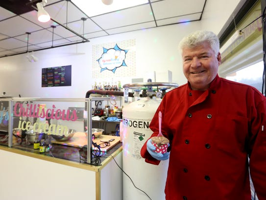 Owner Tyson Mayberry holds ice cream using liquid nitrogen